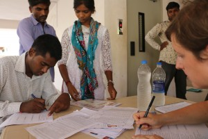 Kristine and Mitesh filling in some forms as applicants  wait for their interviews on June 7. photocredit: Giannina Gaspero-Beckstrom