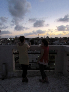 "Photo credit: Kristine Landau. Emma and I standing on the roof watching the sunset over the ""City of Love!"" The ferris wheel can be seen spinning away to my left."